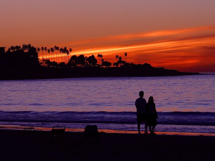 2476-a-couple-on-the-beach-during-sunset-or
